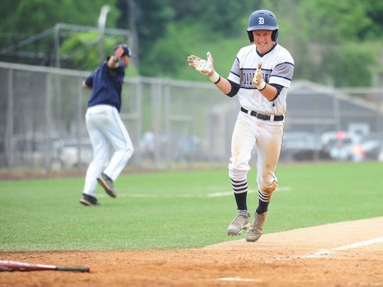 Dallastown outfielder Sean Reding (1) reacts while