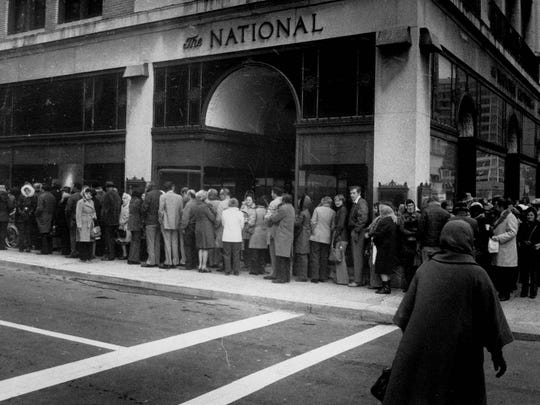Hundreds of shoppers line up in November 1976 to take advantage of National Clothing Co.'s closeout sale at its store at 159 E. Main St.