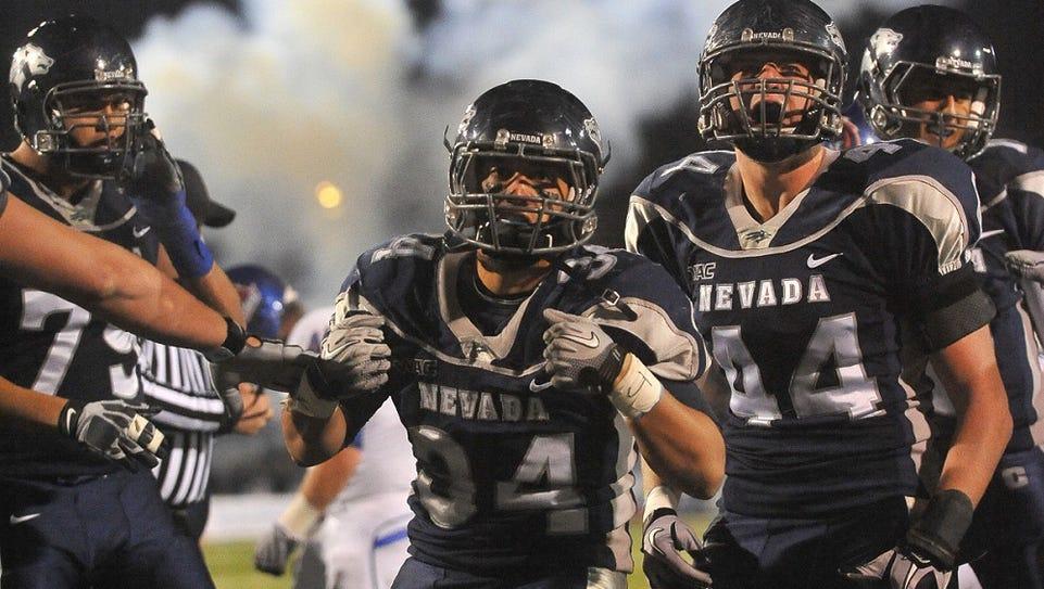 Nevada's Vai Taua and his teammates celebrate a touchdown