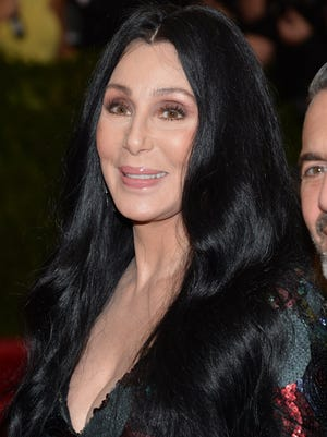 """Cher arrives at The Metropolitan Museum of Art's Costume Institute benefit gala celebrating """"China: Through the Looking Glass"""" on Monday, May 4, 2015, in New York. (Photo by Evan Agostini/Invision/AP)"""
