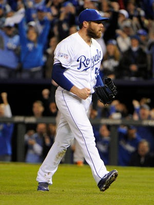 Royals closer Greg Holland reacts after defeating the Orioles 2-1 in Game 3.