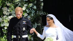 Britain's Prince Harry and Meghan Markle present as