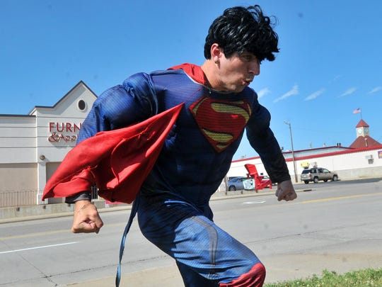 Aaron Vangarde, 27, of Wausau, dressed in Superman costume Monday afternoon, as part of his job at the Little Caesars Pizza on Stewart Avenue in Wausau.