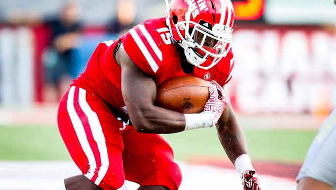 UL running back Elijah McGuire carries th.e ball against Idaho on Saturday