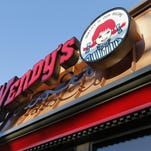 """FILE - This 2014 file photo, shows a Wendy's restaurant in Providence, R.I. Wendy's says it is investigating reports of """"unusual activity"""" on payment cards that had been used at some of its restaurants. The company says it learned from payment industry contacts in January 2016 of reports indicating fraudulent charges may have occurred on cards that had been used legitimately at some of its locations."""