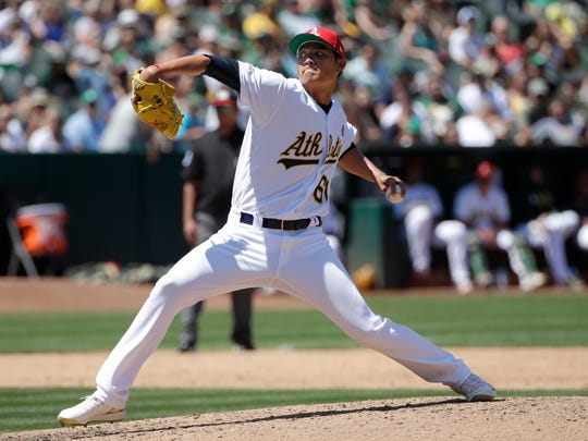 Oakland Athletics pitcher Wei-Chung Wang throws to a Minnesota Twins batter during the fifth inning of a baseball game in Oakland, Calif., Thursday, July 4, 2019. (AP Photo/Jeff Chiu)