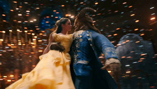 Belle (Emma Watson) enjoys a dance with the Beast (Dan Stevens) in the live action 'Beauty and the Beast.'