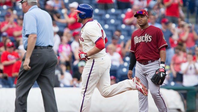 May 17, 2015: Philadelphia Phillies first baseman Darin Ruf (18) rounds the bases in front of Arizona Diamondbacks third baseman Yasmany Tomas (24) after hitting a home run during the fourth inning at Citizens Bank Park.
