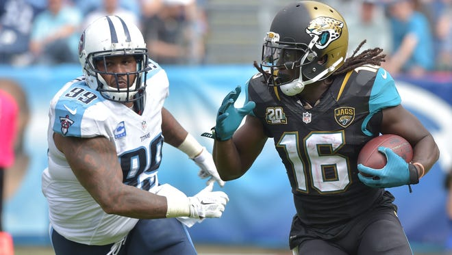 Jacksonville Jaguars wide receiver Denard Robinson (16) carries the ball against Tennessee Titans defensive tackle Jurrell Casey (99) during the second half at LP Field. The Titans beat the Jaguars 16-14.