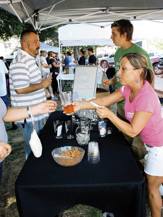 The crew from Artesia's Wellhead Restaurant and Brew Pub kept busy handing out samples of their beers last year at the Microbrew Festival on the Pecos.