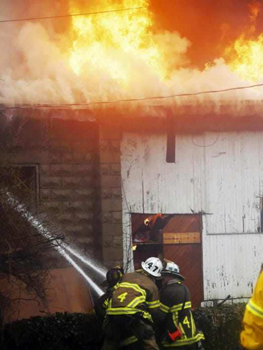Fire fighters respond to a building fire at 80 West Burd Street in Shippensburg on Friday, April 10, 2015. Ryan Blackwell - Public Opinion