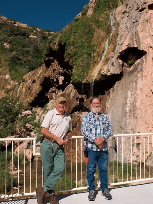 JESSICA ONSUREZ CURRENT-ARGUS   Joe English (left), David Bell (center), both volunteers with the U.S. Forest Service, stand on the newly built observation deck at Sitting Bull Falls in the Lincoln Natinal Park which reopened over Memorial Day weekend after being closed to the public for more than year due to damage from flood waters in 2013.