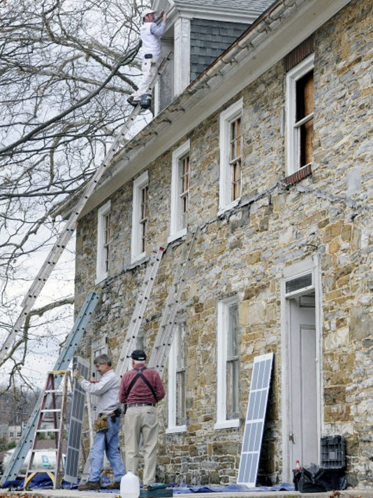 Members of the Friends of the Hoke House began stabilization work on building in Spring Grove Monday after an agreement was reached with Rutter's Farm Stores, which owns the building, to possibly save it from demolition.