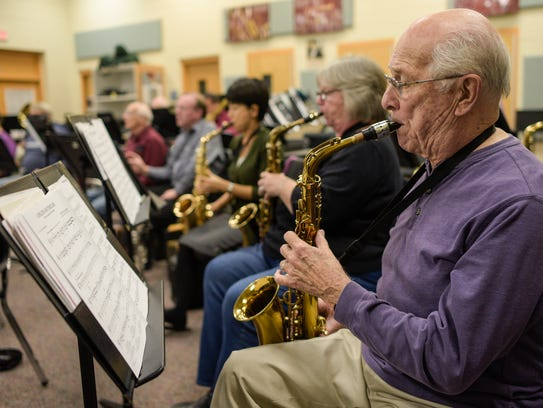 Richard Cywinski plays his saxophone Oct. 12 during