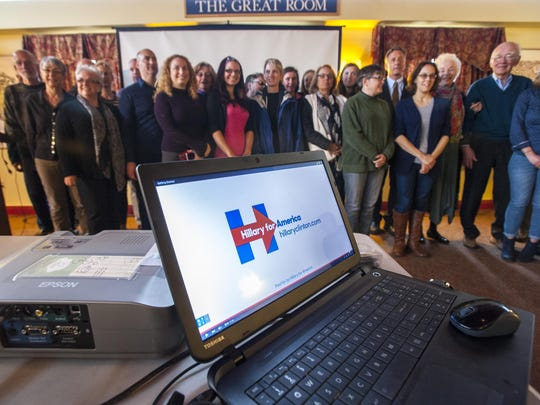 Supporters and volunteers gather for a group photo with Gov. Peter Shumlin and former Gov. Madeleine Kunin at an organizational meeting for Hillary Clinton's presidential campaign in Burlington in June.