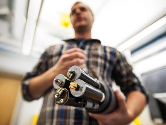 Peter Isles shows a six-sensor sonde at the University