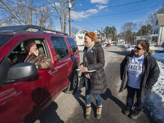 Leslie Roeder of Manhattan, N.Y., center, and Colleen Levesque of Concord N.H., right, chat with Gerhardt Schroeder outside his home as they canvas for Democratic presidential candidate Senator Bernie Sanders, I-Vt., in Concord, New Hampshire on Sunday, February 7, 2016. Schroeder said he would be voting for Sanders in Tuesday's presidential primary.