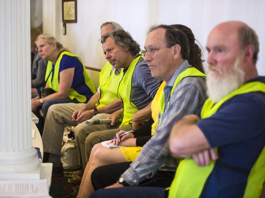 Supporters of a billl that would regulate the siting of wind projectrs listen as the Senate considers the bill at the Statehouse in Montpelier on Friday.