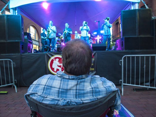 Bill Arsenault of Grand Isle sits right up front to listen to the Macrotones as they perform on Church Street on the opening night of the Discover Jazz Festival in Burlington on Friday, June 3, 2016.
