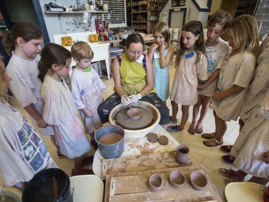 Alexandra Turner, center, gives a demonstration during a lesson at the Burlington City Arts pottery studio in the basement of Memorial Auditorium on Wednesday. The studio has to move out at the end of the year because of concerns over the building's structural stability.