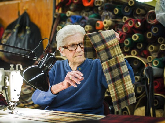 91 year-old Yvonne Allen has been working at Johnson Woolen Mills since she graduated from high school in the 1940's. She is seen sewing a pocket book in Johnson on Wednesday, November 2, 2016.