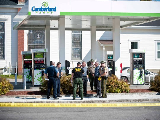 Police investigate a shooting at the CumberlandFarms in Morrisville on Wednesday.