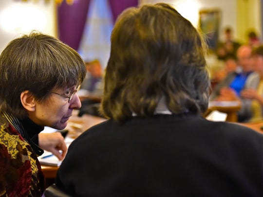 Rep. Ann Donahue, R-Northfield (left), whispers to Sen. Anthony Pollina, P/D-Washington, during a joint meeting of the House and Senate health committees at the Statehouse on Thursday, January 13, 2015.