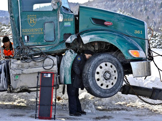 A Vermont State Police cruiser and two other vehicles were damaged when a tractor-trailer truck jackknifed coming down a hill in the northbound lane of I-89 in Montpelier on Tuesday, February 3, 2015. An inspector from the Department of Motor Vehicles examined the truck before it was towed from the scene.