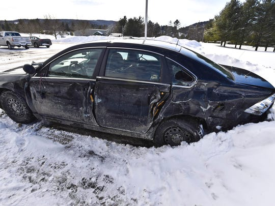 A Vermont State Police cruiser and two other vehicles were damaged when a tractor-trailer truck jackknifed coming down a hill in the northbound lane of I-89 in Montpelier on Tuesday, February 3, 2015. The damaged cruiser is seen after being towed to the VSP Middlesex barracks.