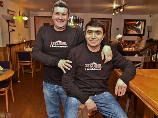Hasan Oktay (left), owner of the Istanbul Kebab House in Burlington with his brother Vural (not pictured), seen with chef Veli Cetin, on Tuesday, February 17, 2015.