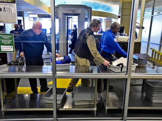 Passengers pass through security at the Burlington International Airport in South Burlington on Tuesday.