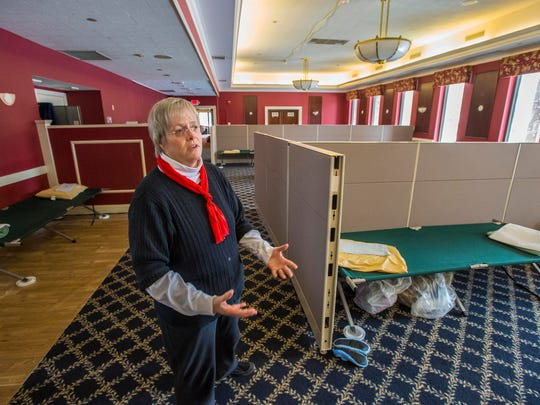 Jan Demers of the Champlain Valley Office of Economic Opportunity gives a tour of a temporary low-barrier shelter at the former Ethan Allen Club in Burlington on Friday.