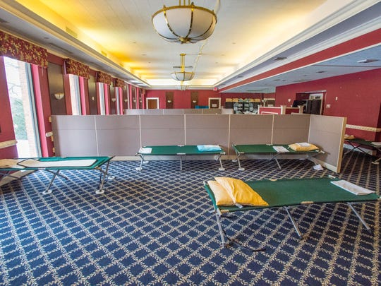 Cots and partitions await a new round of homeless guests at the temporary low-barrier shelter at the former Ethan Allen Club on Friday.