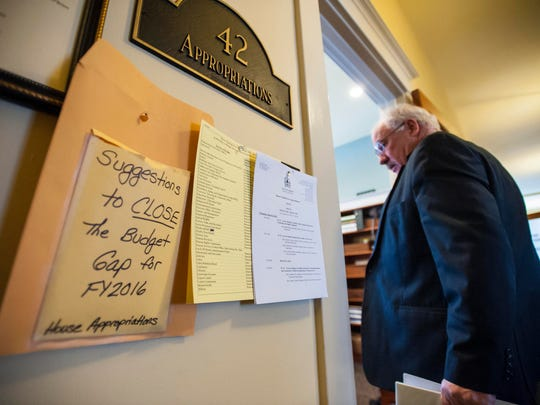 Rep. Robert Helm, R-Castleton, enters the House Appropriations Committee room as the committee considers the state budget at the Statehouse in Montpelier on Thursday.