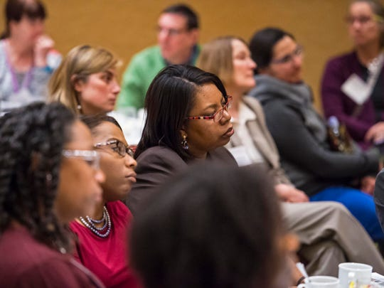 People listen as Carol Moseley Braun, the first African-American woman elected to the U.S. Senate, speaks at a conference sponsored by the Greater Burlington Multicultural Resource Center in Burlington on Monday.