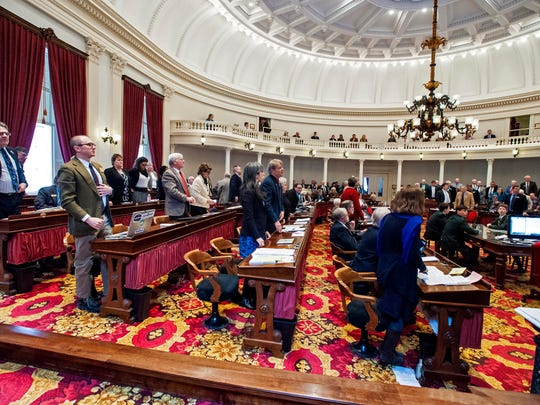 Opponents of a bill to ban teachers strikes stand during a vote at the Statehouse in Montpelier on Thursday. A roll call vote on the question was subsequently called, and the House voted down the bill.
