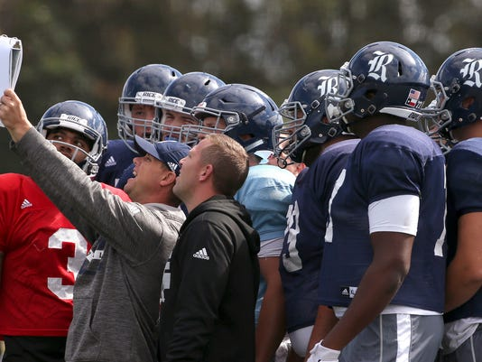 U.S. college Rice's football players get instruction for a running play as their team trains ahead of the season opening game against Stanford in Sydney, Thursday Aug. 24, 2017. The game will be played on Sunday. (AP Photo/Rick Rycroft)