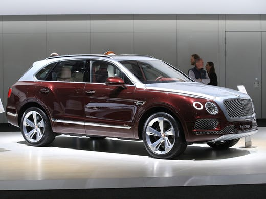 A Two Tone Bentley Bentayga Luxury Suv Stands On Display