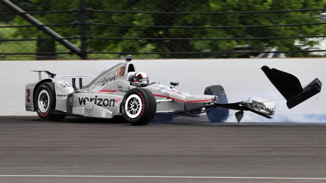 The car driven by Juan Pablo Montoya of Colombia hits the wall in the second turn during the 100th running of the Indianapolis 500 on Sunday.