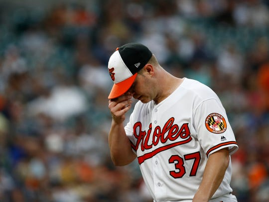Baltimore Orioles starting pitcher Dylan Bundy walks off the field after the top of the third inning of a baseball game against the New York Yankees, Wednesday, July 11, 2018, in Baltimore. New York scored five runs against Bundy in the inning.
