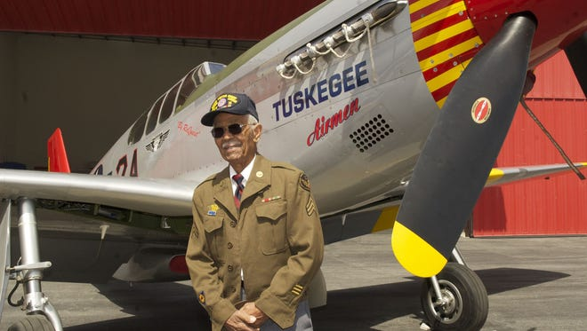 """This April 7, 2011 photo by Bruce Talamon shows Clarence E. """"Buddy"""" Huntley Jr., a member of the Tuskegee Airmen, the famed all-black squadron that flew in World War II, posing with a P-51C Mustang fighter plane similar to the one that he was a crew chief on while overseas during the war, at Torrance, Calif., Airport. Huntley and fellow Tuskegee Airman Joseph Shambrey, lifelong friends who enlisted together, both died on the same day, Monday, Jan. 5, 2015, in their Los Angeles homes, relatives said Sunday, Jan. 11, 2015. Both were 91. Huntley and Shambrey enlisted in 1942 and were shipped overseas to Italy in 1944 with the 100th Fighter Squadron of the Army Air Force's 332nd Fighter Group. As mechanics, they kept the combat planes flying."""