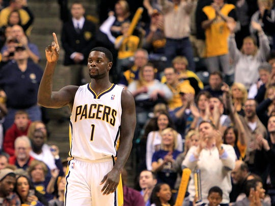Indiana's Lance Stephenson celebrates as the Pacers move to 12-1 after beating Philadelphia 106-98, Saturday, November 23, 2013, at Bankers Life Fieldhouse.