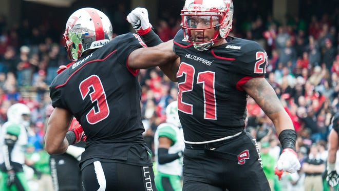 Nov 27, 2015; Bowling Green, KY, USA; Western Kentucky Hilltoppers wide receiver Antwane Grant (3) celebrates with wide receiver Jared Dangerfield (21) after scoring a touchdown during the second half against Marshall Thundering Herd at Houchens Industries-L.T. Smith Stadium. Western Kentucky Hilltoppers won 49-28. Mandatory Credit: Joshua Lindsey-USA TODAY Sports