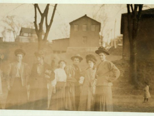 A 1909 photo shows some of the girls from the Chace Cotton Mill in Burlington. Girl on left end is Cora Collette. Girl in middle is Anna Grenier.