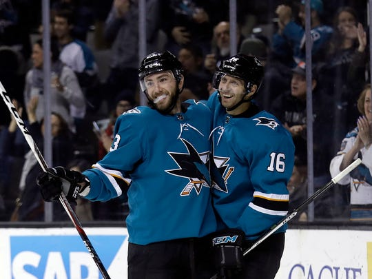 San Jose Sharks' Barclay Goodrow, left, celebrates his goal with teammate Eric Fehr during the second period of an NHL hockey game against the New Jersey on Devils Tuesday, March 20, 2018, in San Jose, Calif. (AP Photo/Marcio Jose Sanchez)