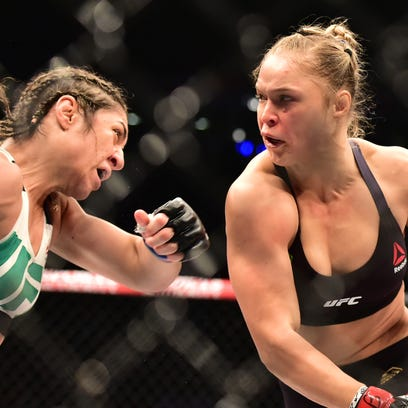 RIO DE JANEIRO, BRAZIL - AUGUST 01:  Ronda Rousey of the United States defeats Bethe Correia of Brazil in their bantamweight title fight during the UFC 190 Rousey v Correia at HSBC Arena on August 1, 2015 in Rio de Janeiro, Brazil.  (Photo by Matthew Stockman/Getty Images) ORG XMIT: 567162381 ORIG FILE ID: 482712272