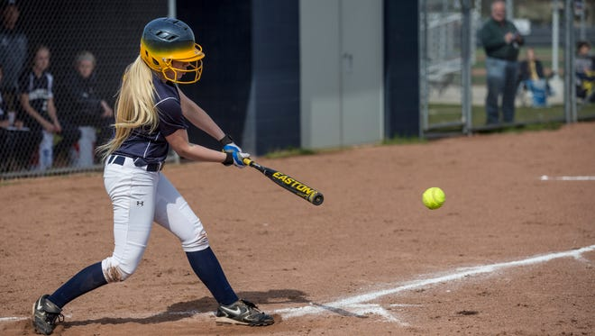 Port Huron Northern's Heidi Wilson gets a hit during a softball game Tuesday, May 17, 2016 at Marysville High School.