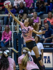 Piedra Vista's Bebe Jaques tips the ball over the net on Tuesday at Jerry A. Conner Fieldhouse in Farmington.
