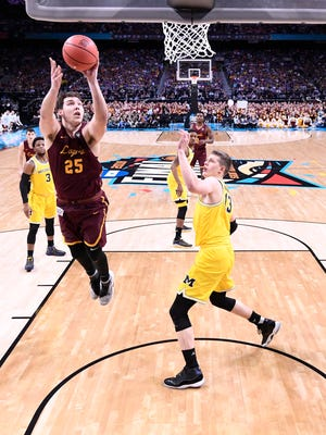 Loyola Ramblers center Cameron Krutwig (25) shoots against Michigan Wolverines forward Moritz Wagner (13) in the first half in the semifinals of the 2018 men's Final Four at Alamodome.