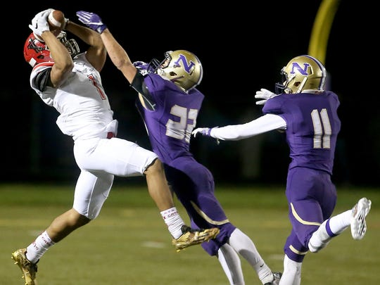 Archbishop Murphy's Kyler Gordon (left) makes a catch during last year's state playoff game against North Kitsap. Gordon and the Wildcats are the defending Class 2A state champions.